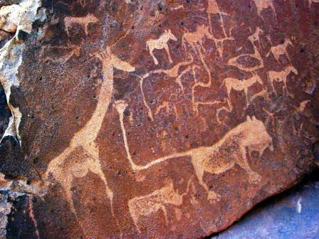 the art of africa petroglife with lion and girafe